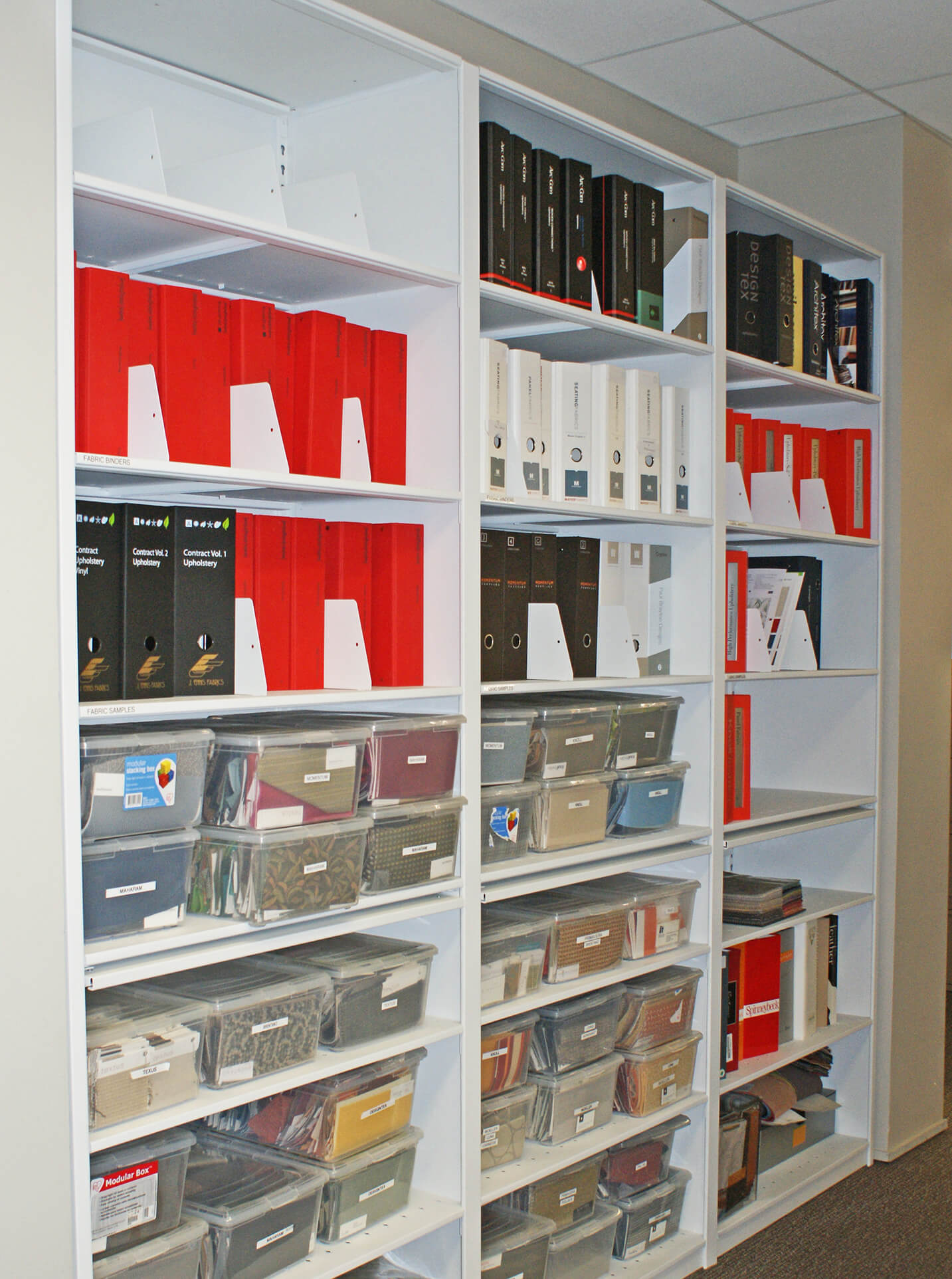 Toronto Interior Design Company reference material on 4-Post shelving with pull-out reference shelves