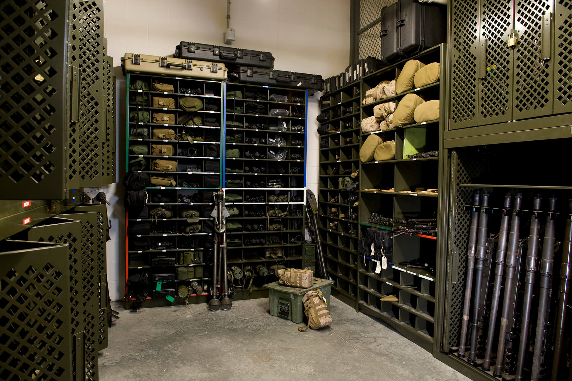 Universal weapons racks and racking for optics in armory