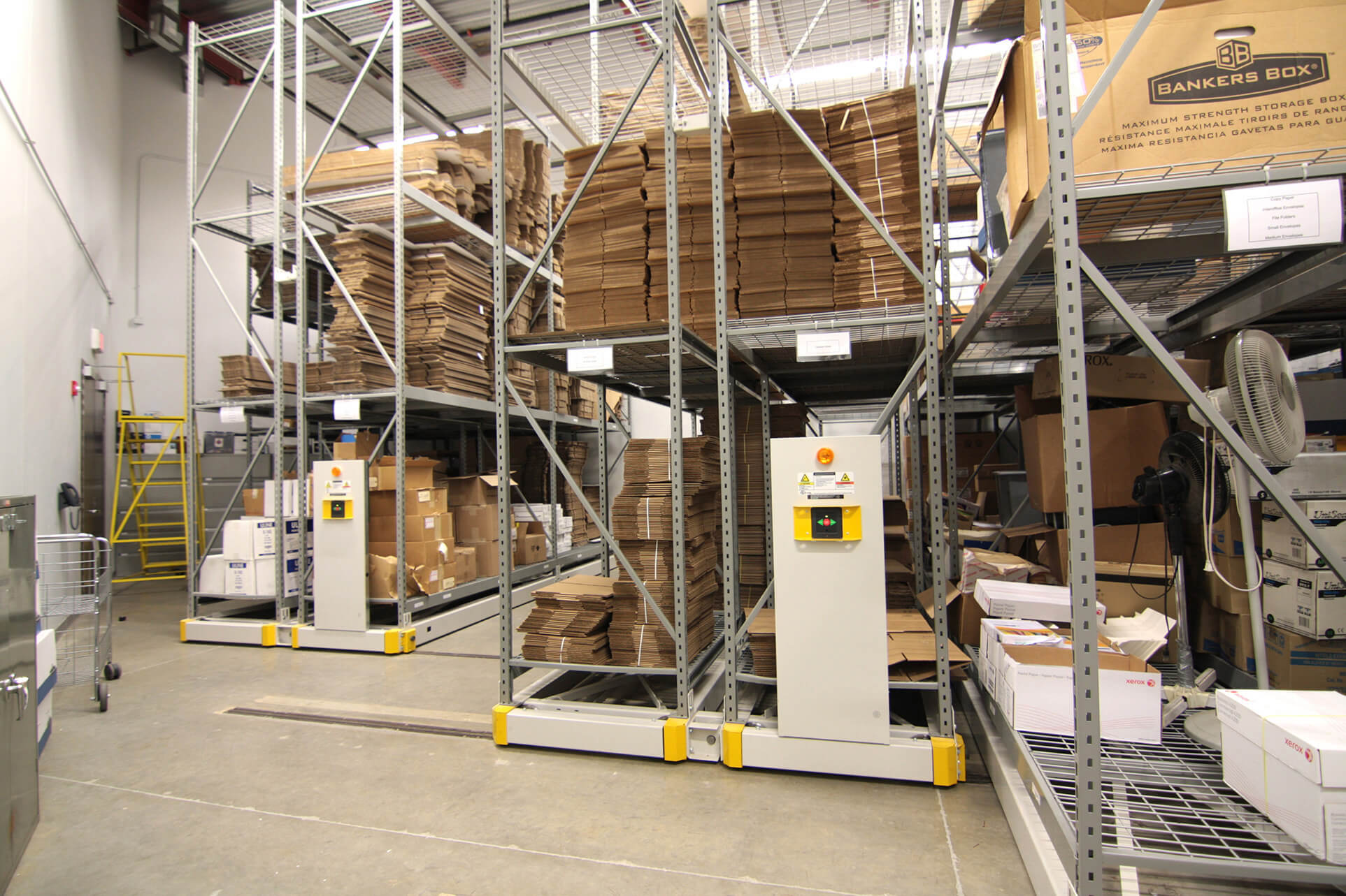 Wide span racking on compact mobile storage system in evidence room