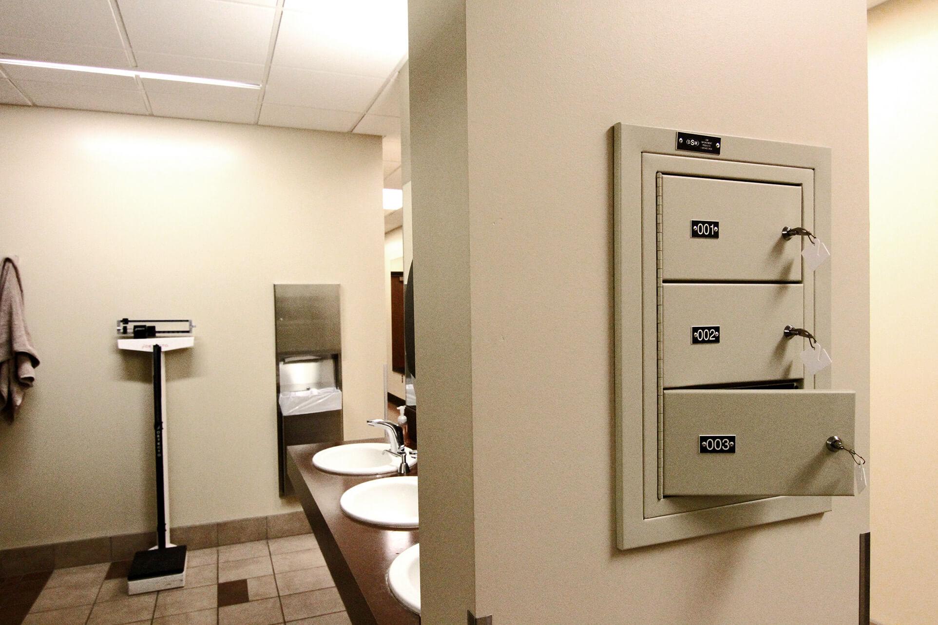 Sally port locker for gun security in locker room