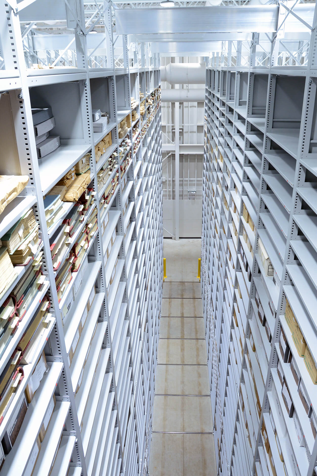 Archival Library Shelving on 34 foot tall compact mobile storage system