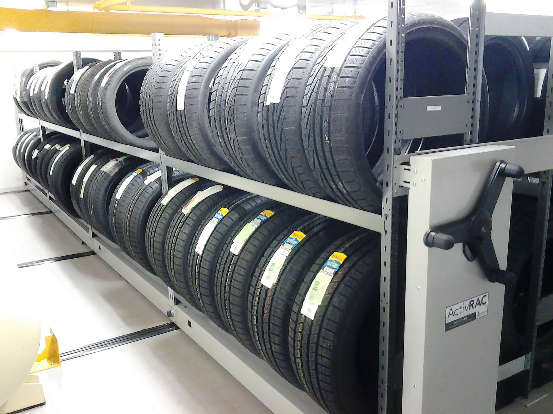 Tire storage on mechanical assist compact industrial racking