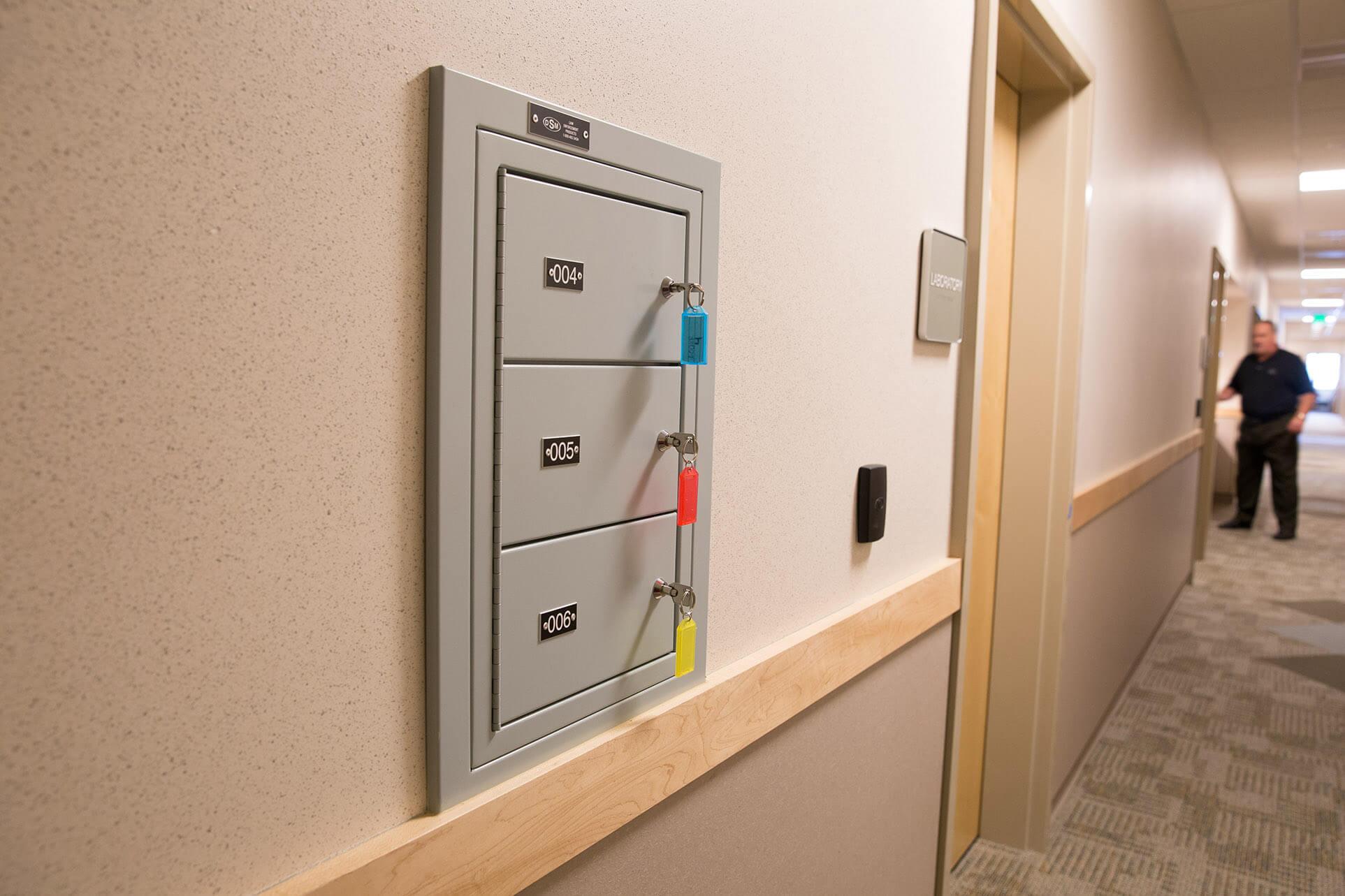Sally port gun locker mounted flush with wall inside police department