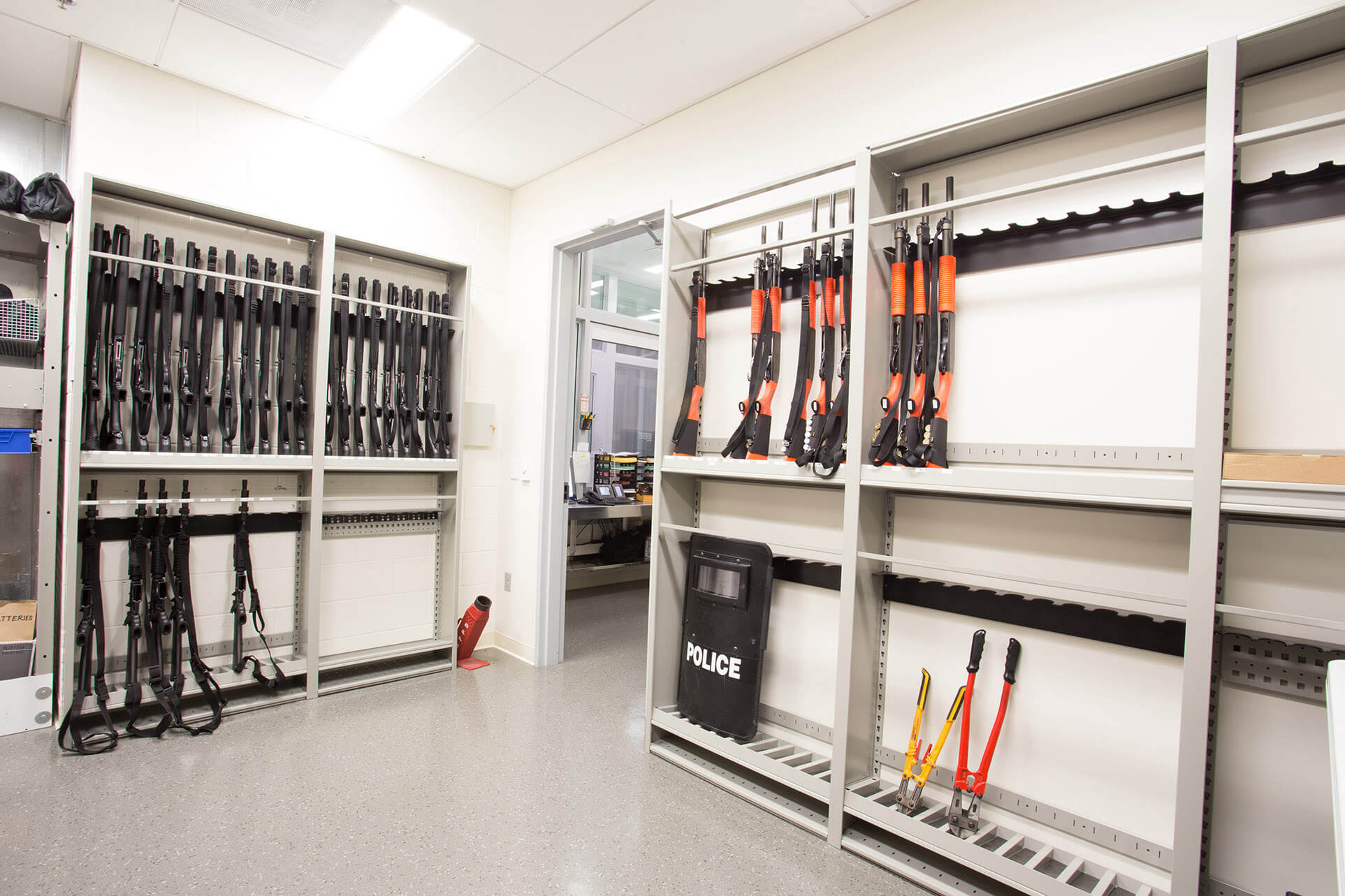 Riot gear stored on wall mounted Weapons Racks