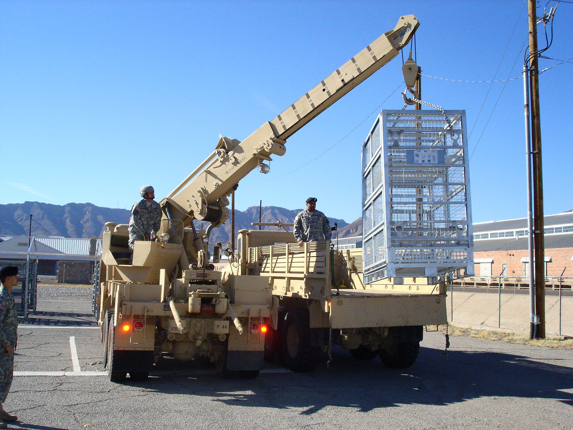 Deployable Military Container Being Sling-Loaded for Deployment