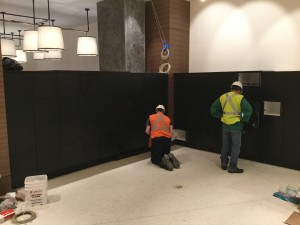 Spacesaver installers working on Package Delivery Lockers
