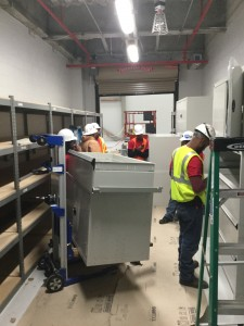 Spacesaver installers working on drawer cabinets stacked 10 feet tall