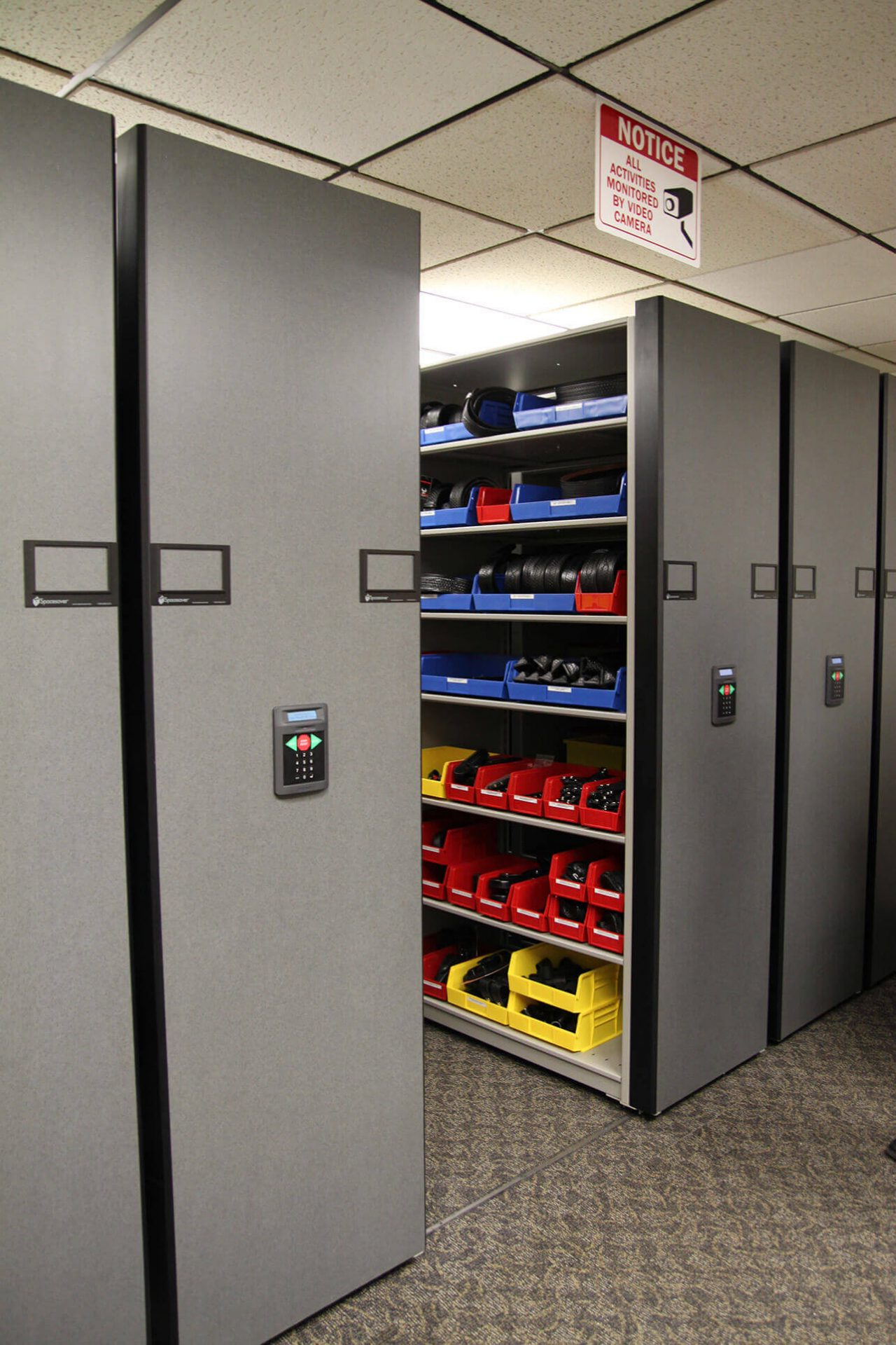Badge Storage utilizing compact shelving