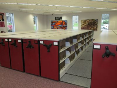 Book cases with mechanical assist system