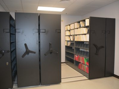 Space saving File storage via Mechanical Assist System