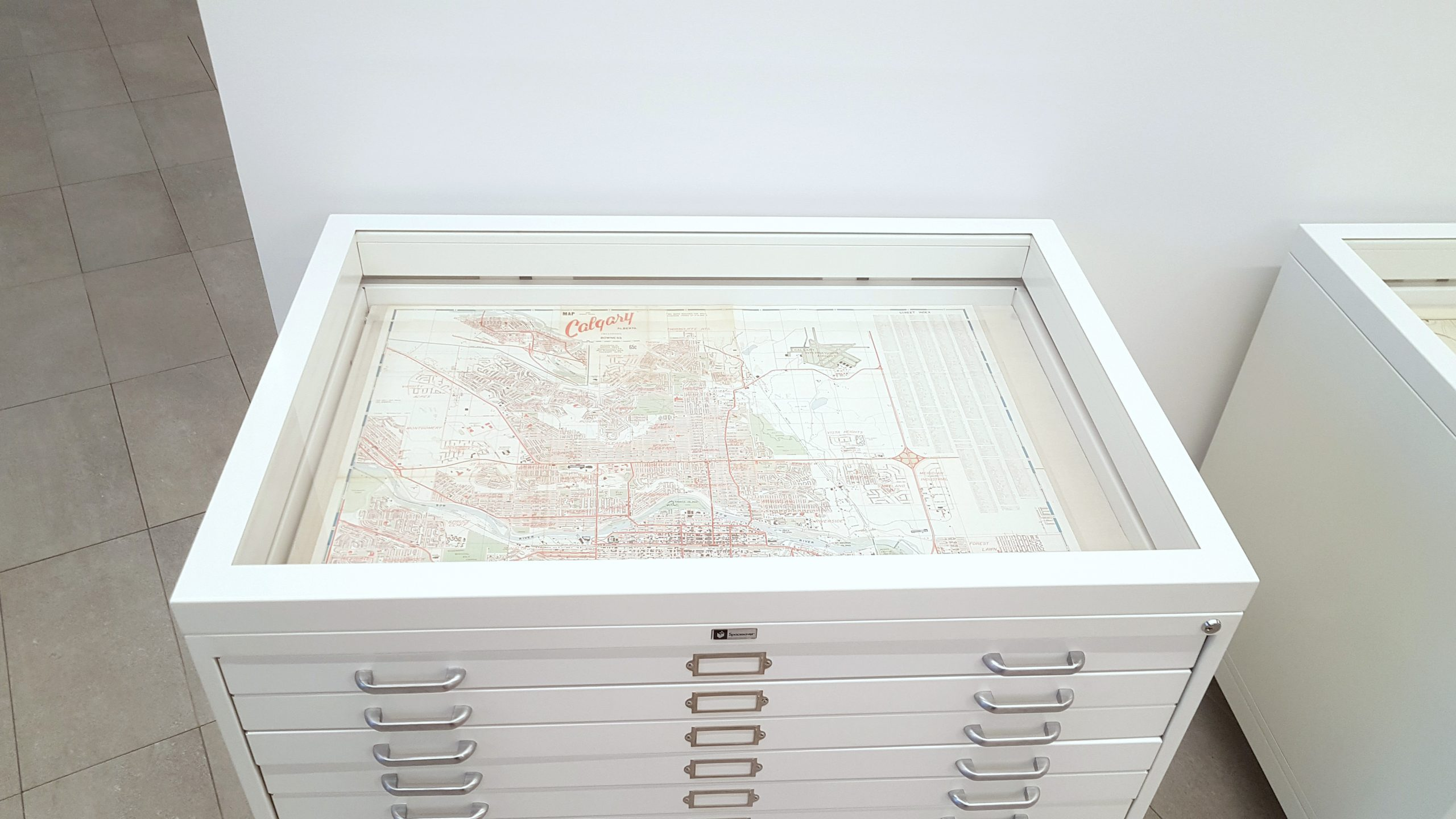 Flat file glass display case