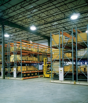 Fork lift accessing pallets stored on ActivRAC 30 mobilized racking storage system