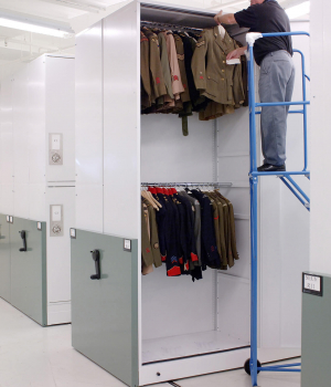 Preserving Uniforms using garment rods on mechanical assist mobile storage system at Canadian War Museum Ottawa