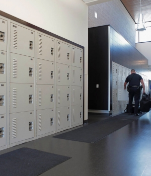 Built in wall of personal storage lockers for easy access of gear bags