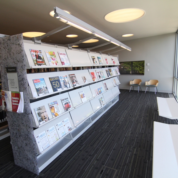 Magazine racks on cantilever library Shelving with unique acrylic endpanels