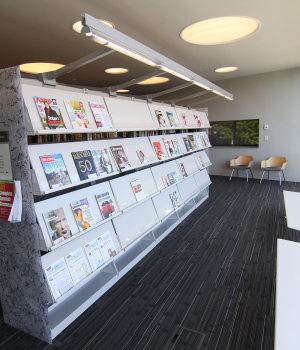 Magazine racks on cantilever library Shelving with unique acrylic end panels