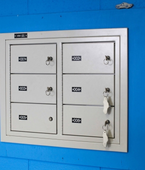 Six compartment wall mounted gun locker