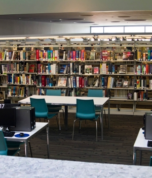 Common work area between Library book storage on cantilever shelving