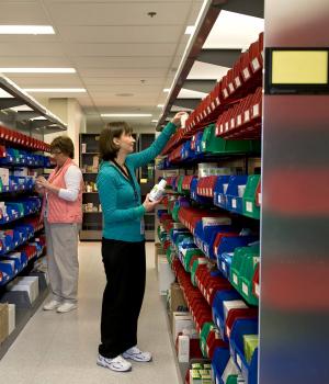 Pharmacy Technicians gather medicine from modular bin storage