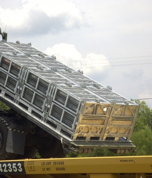 Set of Deployable Military Containers Being Transported