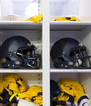 helmet athletic equipment storage in bins at university