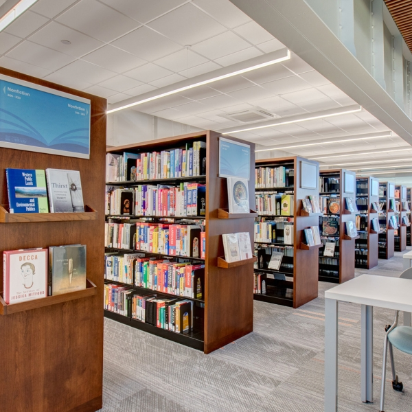 Work stations next to cantilever bookstacks in public library